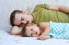 Cute baby ailing with daddy Stock Photo