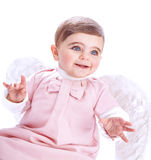 Cute baby angel. Closeup portrait of cute baby angel isolated on white background, nice little girl wearing pink dress and feather wings, angelic costume Stock Photos