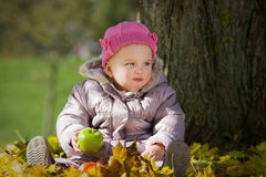 Cute baby with apple Royalty Free Stock Photo