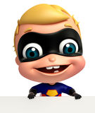 cute baby as a superhero with white board Royalty Free Stock Photos