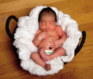 Cute baby asleep in basket Royalty Free Stock Images