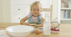 Cute baby baking in a kitchen Royalty Free Stock Photography