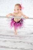 Cute baby ballerina. Cute baby girl with pearls and tutu skirt - studio shot Stock Photo