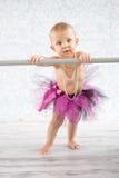 Cute baby ballerina. Cute baby girl with pearls and tutu skirt - studio shot Stock Photos