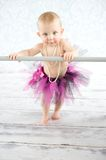 Cute baby ballerina. Cute baby girl with pearls and tutu skirt - studio shot Stock Images