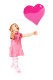 Cute baby with ballon. Cute happy baby girl with heart ballon Stock Photography