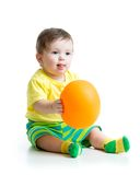 Cute baby with ballon in hands. Cute baby boy with ballon in hands isolated on white Stock Photo
