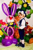 Cute baby in balloon forest Royalty Free Stock Photos