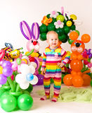 Cute baby in balloon forest Royalty Free Stock Photography