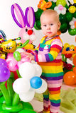 Cute baby in balloon forest Stock Photo