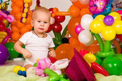 Cute baby in balloon forest Stock Images