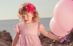 Cute baby with balloon Stock Photography