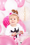 Cute baby with balloons Stock Image