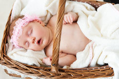 Cute baby in a basket. Royalty Free Stock Photos