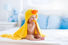 Cute baby after bath in yellow duck towel Royalty Free Stock Images