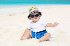 Cute baby on the beach Stock Photos