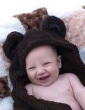Cute baby bear. Cute baby in brown bear robe royalty free stock image