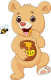 Cute baby bear holding honey pot isolated on white background Stock Photo