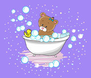 Cute baby bear swims in the bathtub Stock Photography