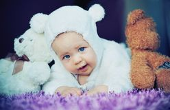 Cute baby with bears Royalty Free Stock Image
