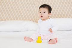Cute baby on bed Royalty Free Stock Photography