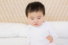 Cute baby on bed Royalty Free Stock Images