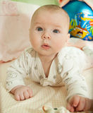 Cute baby in bed Royalty Free Stock Photography