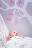 Cute baby in bedroom Stock Photos