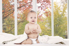 Cute baby in bedroom looking at camera Stock Photography