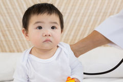Cute baby being visited by doctor Stock Photography