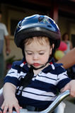 Cute Baby with bicycle helmet. Cute baby with a blue bicycle helmet royalty free stock image
