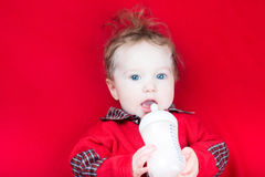 Cute baby with big blue eyes drinking milk Royalty Free Stock Photo