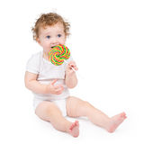 Cute baby with a big candy on white background Royalty Free Stock Photos