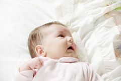 Cute baby on blanket. Looking sideways mouth open Stock Photos