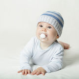 Cute baby in blue clothes Royalty Free Stock Image