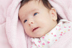 Cute baby with blue eyes Stock Images