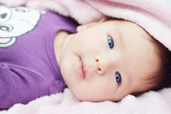 Cute baby with blue eyes Stock Photos