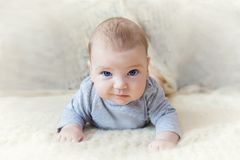 Cute baby with blue eyes crawling forward.  royalty free stock images