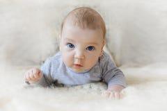 Cute baby with blue eyes crawling forward.  stock photos