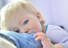 Cute baby with blue eyes. Royalty Free Stock Images