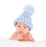 Cute baby in bobble hat. Portrait of cute baby boy in cosy blue bobble hat, isolated on white background Royalty Free Stock Images