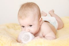 Cute baby with bottle of milk Royalty Free Stock Image