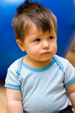 Cute baby boy. Portrait of cute baby boy with brown hair indoors Royalty Free Stock Photo
