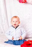 Cute baby boy on a bed playing Royalty Free Stock Images