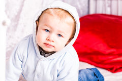 Cute baby boy on a bed playing Stock Image