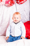 Cute baby boy on a bed playing Stock Photo