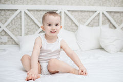 Cute baby boy in bed Stock Photo