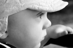 Cute baby boy black white. Cute baby boy (10 months old) in peaked cap Stock Images