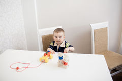 Cute baby boy with blocks Stock Photos