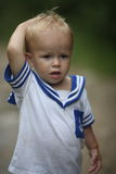 Cute baby boy. In blond hair with sailor style top royalty free stock images